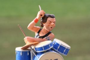 A cartoon drummer playing drums